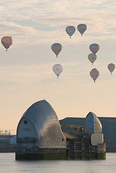 © Licensed to London News Pictures. 10/09/2017. London, UK. Over 30 hot air balloons have lifted off in London for the City of London's Lord Mayor's Hot Air Balloon Regatta. Now in it's third year, the fund raising regatta took from City Airport to mark its 30th birthday this year. The flotilla of balloons set off at 7am and drifted north east towards East London and Essex. Photo credit : Rob Powell/LNP