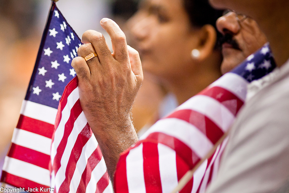 """July 2, 2010  - PHOENIX, AZ: Nearly 200 people were sworn in as US citizens during the """"Fiesta of Independence"""" at South Mountain Community College in Phoenix, AZ, Friday. The ceremony is an annual event on th 4th of July weekend and usually the largest naturalization ceremony of the year in the Phoenix area.  Photo by Jack Kurtz"""