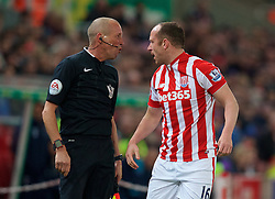 STOKE-ON-TRENT, ENGLAND - Monday, April 18, 2016: Stoke City's Charlie Adam argues with the fourth official during the FA Premier League match against Tottenham Hotspur at the Britannia Stadium. (Pic by David Rawcliffe/Propaganda)