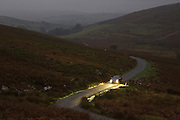 Mercedes car drives along a country road at night, Dartmoor, Devon,  United Kingdom