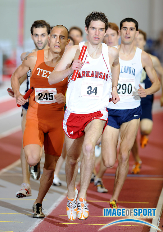Mar 14, 2008; Fayetteville, AR, USA; Daniel LaCava of Arkansas (34) and Jacob Hernandez of Texas (245) lead the opening 1,200m leg in the distance medley relay in the NCAA indoor track and field championships at the Randal Tyson Center.