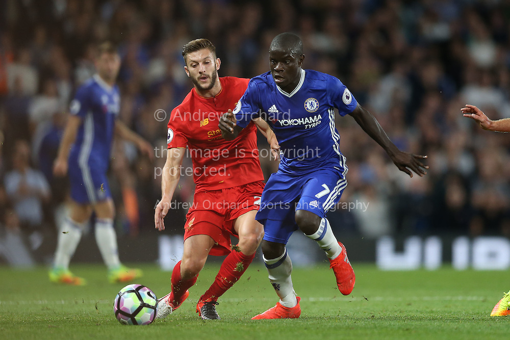 Ngolo Kante of Chelsea holds off Adam Lallana of Liverpool.  Premier league match, Chelsea v Liverpool at Stamford Bridge in London on Friday 16th September 2016.<br /> pic by John Patrick Fletcher, Andrew Orchard sports photography.