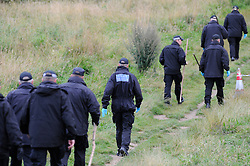© Licensed to London News Pictures. 06/08/2012 . Police searching Spring Parknear Croydon, South London for Missing 12 year old Tia Sharp, on August 6, 2012. 12 year old Tia Sharp has been missing from the Lindens on The Fieldway Estate in New Addington since Friday last week. Photo credit : Grant Falvey/LNP
