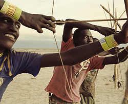 October 3, 2018 - Lake Eyasi, Ngorongoro district, Tanzania - Young Hadza men test their daily hand-made arrows.The Hadza are one of the last remaining societies, which remain in the world, that survive purely from hunting and gathering. Very little has changed in the way the Hadza live their lives. (Credit Image: © Stefan Kleinowitz/ZUMA Wire)