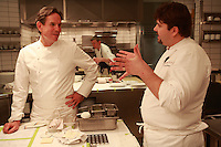 in the kitchen of the restaurant Per Se, in NY..Chef Thomas Keller on left..Photograph by Owen Franken ..