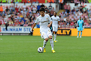 Swansea city's Ki Sung-Yueng makes his debut. Barclays Premier league, Swansea city v Sunderland at the Liberty Stadium in Swansea, South Wales on Saturday 1st Sept 2012. pic by Andrew Orchard, Andrew Orchard sports photography,