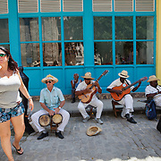 Cuban government  is allowing private business to flourish. Musicians play for tips on the streets of La Habana Vieja.<br />