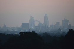 © Licensed to London News Pictures. 29/09/2013. Richmond, UK The London skyline seen in the early morning haze from Richmond Park on September 29th 2013. Photo credit : Stephen Simpson/LNP