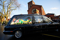 © licensed to London News Pictures. London, UK 03/01/2014. Coffin of the Great Train Robber Ronnie Biggs taken to his funeral at Golders Green crematorium in north London. Biggs died on December 18, 2013 aged 84 after famously spent 35 years on the run from prison. Photo credit: Tolga Akmen/LNP
