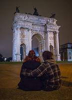 Milan, Italy- December 4, 2014: A couple enjoys a moment in front of the Acro della Pace at Piazza Sempione. CREDIT: Chris Carmichael for The New York Times