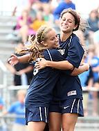 May 12, 2012; Huntsville, AL, USA;  Oak Mountain's Vicki Hill (5) hugs Oak Mountain's Julianne Jackson (12) after Hill scored the only goal against Auburn. Mandatory Credit: Marvin Gentry