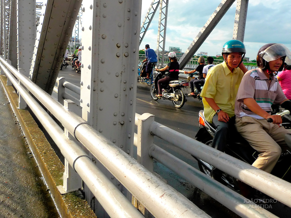 Scooters crossing one of Hué's bridges