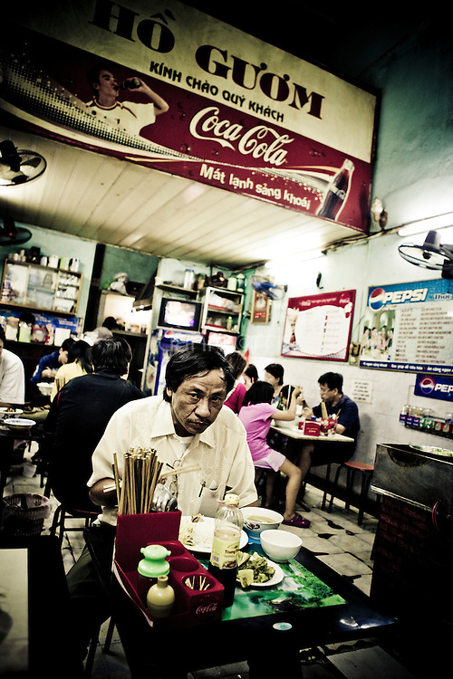 Man eating Pho in noodle shop, French Quarter, Hanoi, Vietnam