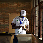 A member of the Burundian National Independent Electoral Commission counts votes for the parliamentary elections at a polling station near Musaga neighbourhood, Bujumbura, June 29, 2015.