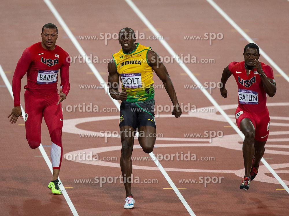 05.08.2012, Olympia Stadion, London, GBR, Olympia 2012, 100m Finale, Herren, im Bild Ryan Bailey (USA), Usain Bolt (JAM, Gold Medaille), Justin Gatlin (USA, Bronze Medaille)  // Ryan Bailey (USA), Gold Medal Usain Bolt (JAM) and bronze medal Justin Gatlin (USA) during Men 100m Final at the 2012 Summer Olympics at Olympic Stadium, London, United Kingdom on 2012/08/05. EXPA Pictures © 2012, PhotoCredit: EXPA/ Johann Groder