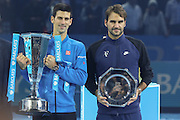 Novak Djokovic and Roger Federer with their trophies during the final of the ATP World Tour Finals between Roger Federer of Switzerland and Novak Djokovic at the O2 Arena, London, United Kingdom on 22 November 2015. Photo by Phil Duncan.