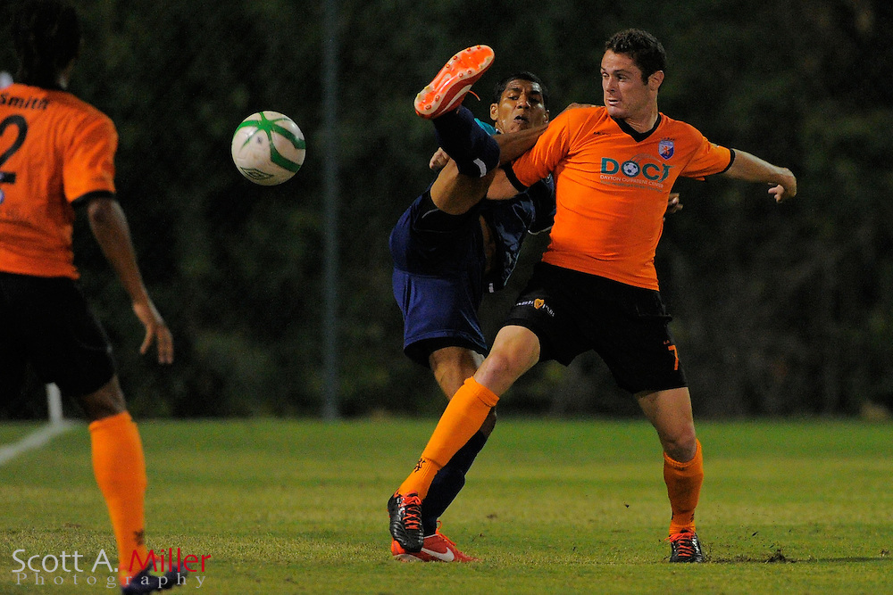 VSI Tampa Bay FC defender Sean Reynolds (18) Dayton Dutch Lions forward Gibson Bardsley (7) fight for the ball during a USL-Pro soccer game at the Plant City Stadium in Plant City, Florida April 26, 2013. Dayton won 1-0...©2013 Scott A. Miller