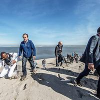 Nederland, Lelystad, 24 september 2016.<br /> Op zaterdag 24 september 2016 zet staatssecretaris Martijn van Dam van Economische Zaken (natuur) als eerste voet op de Marker Wadden. Natuurmonumenten legt samen met Rijkswaterstaat en Boskalis de komende jaren een archipel aan eilanden aan, die de natuur in het Markermeer een enorme impuls gaat geven. De staatssecretaris brengt samen met natuur- en watersportliefhebbers een bezoek aan het eerste eiland van dit innovatieve en grootschalige natuurproject. Dit eerste eiland omvat circa 250 hectare. De eerste fase van Marker Wadden omvat in totaal zo&rsquo;n 800 hectare, boven- en onderwaternatuur, en moet klaar zijn in 2020.<br /> Op de foto: Staatsecretaris Martijn van Dam en zijn gevolg zet voet aan de grond van de eerste Marker eiland.<br /> <br /> Netherlands, Lelystad, September 24, 2016<br /> On Saturday, September 24th 2016 Martijn van Dam, secretary of Economic Affairs (nature) first sets foot on the Marker Wadden. Natuurmonumenten lays together with Rijkswaterstaat and Boskalis (Royal Boskalis Westminster N.V. is a leading global services provider operating in the dredging, maritime infrastructure and maritime services sectors) an archipelago of islands in the coming years that will give nature in the Markermeer a huge boost.<br /> Natuurmonumenten (Dutch Society for Nature Conservation) is going to restore one of the largest freshwater lakes in western Europe by constructing islands, marshes and mud flats from the sediments that have accumulated in the lake in recent decades. These 'Marker Wadden' will form a unique ecosystem that will boost biodiversity in the Netherlands. (source: www.natuurmonumenten.nl)<br /> The Secretary reunites with nature and water sports enthusiasts visiting the first island of this innovative and large-scale conservation project. This first island comprises approximately 250 hectares. The first phase of Marker Wadden comprises a total of 800 hectares, above and underwater nature, and 