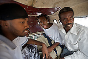 2Double argues with a passenger in the back of a taptap on his way home to Cite Soleil, the most notorious slum in Port-au-Prince, Haiti on July 19, 2008. The rap artist sings about growing up in the hood and hopes his music will someday provide his family with a better life.