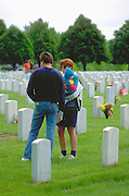 Family age 22 and 1 remembering fallen soldier on Memorial Day. Fort Snelling Military Cemetery Minneapolis Minnesota USA