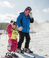 Isabelle and Ethie Ritson make their way over to Gunstock's Wonder Carpet for Isabelle's second lesson on skis Wednesday morning.  (Karen Bobotas/for the Laconia Daily Sun)