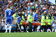 Didier Drogba of Chelsea is stretchered off during the Barclays Premier League match at Stamford Bridge stadium, London...Picture by Paul Chesterton/Focus Images Ltd.  07904 640267.27/8/11