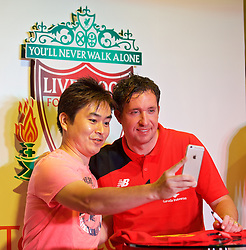 BANGKOK, THAILAND - Tuesday, July 14, 2015: Liverpool ambassador Robbie Fowler poses for a selfie with a supporter during a signing session at the CentralWorld shopping mall in Bangkok on day two of the club's preseason tour. (Pic by David Rawcliffe/Propaganda)
