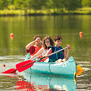 Three persons in a canoe