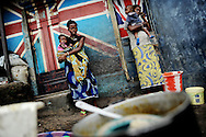 Marbella Slum, Freetown, Sierra Leone - two women and their young children. One health centre provides health care in this part of town for around 15 000 people.
