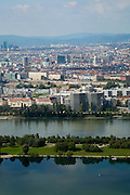 Panoramic Cityscape of Vienna and the New Danube river, viewed from the Donauturm (English: Danube Tower). Austria