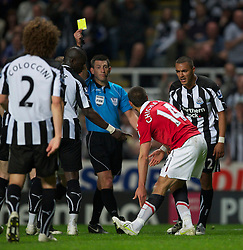 NEWCASTLE, ENGLAND - Tuesday, April 19, 2011: Manchester United's Javier Hernandez is shown the yellow card by referee Lee Probert for diving during the Premiership match against Newcastle United at St James' Park. (Photo by David Rawcliffe/Propaganda)