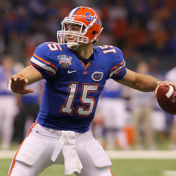 Jan 01, 2010; New Orleans, LA, USA;  Florida Gators quarterback Tim Tebow (15) looks to pass against the Cincinnati Bearcats during the second half of the 2010 Sugar Bowl at the Louisiana Superdome.  Mandatory Credit: Derick E. Hingle-US PRESSWIRE.
