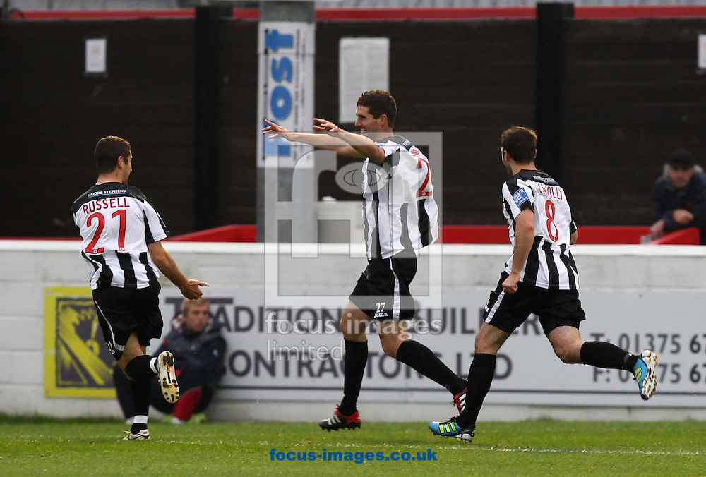 Picture by John Rainford/Focus Images Ltd. 07506 538356.12/11/11.Sean Canham of Bath City is followed by Alex Russell and Adam Connolly after opening the scoring against Dagenham & Redbridge during the FA Cup 1st round match at Victoria Road stadium, Dagenham.