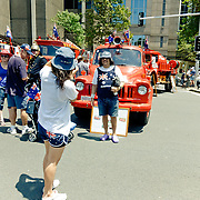 People taking pictures of each other in front of firetruck During Australia Day.