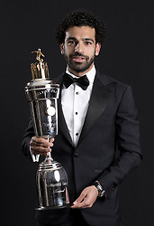 Liverpool's Mohamed Salah poses with the PFA Player Of The Year Award Trophy during the 2018 PFA Awards at the Grosvenor House Hotel, London