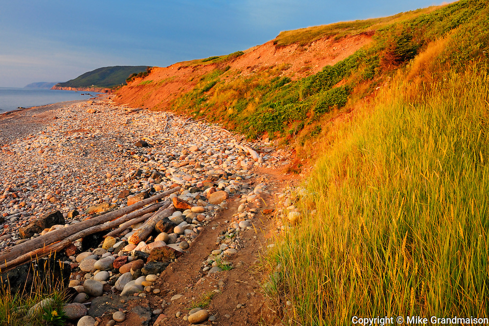 Red cliffs at sunset on Cabot Trail<br /> Pleasant Bay<br /> Nova Scotia<br /> Canada