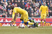 Leeds United Forward, Souleymane Doukara is tackled during the Sky Bet Championship match between Blackburn Rovers and Leeds United at Ewood Park, Blackburn, England on 12 March 2016. Photo by Mark Pollitt.