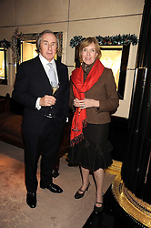 SIR JACKIE & LADY STEWART at a party to celebrate the launch of a collection of jewellery by Tamara Ecclestoen for jewellers Moussaieff held at their store in New Bond Street, London on 9th December 2008.