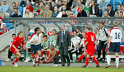 OSLO, NORWAY - Thursday, May 27, 2004:  Wales' manager Mark Hughes shouts at Norway's Martin Andresen after a challenge during the International Friendly match at the Ullevaal Stadium, Oslo, Norway. (Photo by David Rawcliffe/Propaganda)