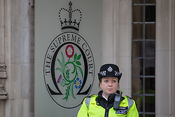 © Licensed to London News Pictures. 05/12/2016. London, UK. A policewoman stands guard outside the Supreme Court in Westminster. The Supreme Court hearing of the Government's appeal against an earlier High Court decision which ruled that Parliament must give consent before Brexit negotiations can begin. Photo credit: Rob Pinney/LNP