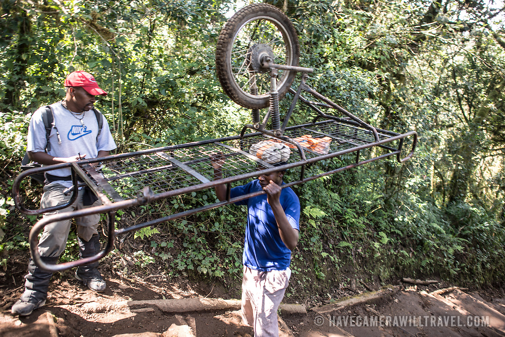 A porter carries an ambulance trolley back up the mountain after it had been used for an emergency evacuation the previous evening on Mt Kilimanjaro.