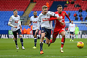 MK Dons forward, on loan from Norwich City, Josh Murphy  and Bolton Wanderers midfielder Josh Vela  battle for the ball during the Sky Bet Championship match between Bolton Wanderers and Milton Keynes Dons at the Macron Stadium, Bolton, England on 23 January 2016. Photo by Simon Davies.