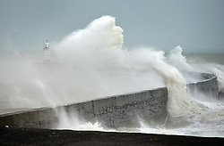 © Licensed to London News Pictures. 15th January 2018. Newhaven, UK. Large waves crash against the lighthouse at the port of Newhaven as strong winds across the South Coast whip up stormy weather in the English Channel. Photo credit: Peter Cripps/LNP