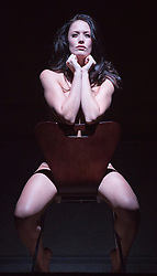 "© Licensed to London News Pictures. 01/11/2013. London, England. Picture: Sarah Armstrong as Christine Keeler in the famous chair pose. The play ""Keeler"", the inside story of the Profumo Affair based on the book ""The Truth at Last"" by Christine Keeler opens at the Charing Cross Theatre with Sarah Armstrong as Christine Keeler and Paul Nicholas as Stephen Ward. The play is scheduled to run from 31 October to 14 December 2013. Photo credit: Bettina Strenske/LNP"