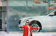 SHANGHAI, CHINA - FEBRUARY 24: (CHINA OUT) <br /> <br /> A woman takes selfies with the luxury car with carps around in a fish tank at Xintiandi on February 24, 2016 in Shanghai, China. A car brand set the luxury car into a fish tank as an installation art.<br /> ©Exclusivepix Media