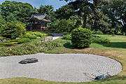 Richmond Upon Thames, London, England, UK, July 7 2018 - Japanese Gateway and Japanese garden at Kew gardens. The Gateway was built for the Japan-British Exhibition (1910) and moved to Kew in 1911. It is a four-fifths scale replica of the karamon (gateway) of the Nishi Hongan-ji temple in Kyoto<br /> Kew Gardens (or Royal Botanical Gardens, Kew) is a botanical garden in southwest London. It is one of London's top tourist attractions and is a World Heritage Site. The site of 121 hectares opened in 1759 and houses more than 30,000 different kinds of plants and 40 listed buildings and structures, including the world's greatest glasshouse.