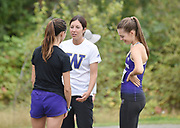 Washington Huskies director of cross country and track and field Maurica Powell talks to Camila David-Smith (in black) and Hannah Waskom before the women's 3 mile run at the UW/Seattle University Open at Warren G. Magnuson Park, Friday, Aug. 30, 2019, in Seattle. (Paul Merca/Image of Sport)