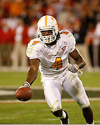 Tennessee DB Jonathan Wade reaches to give the ball to the referee after his interception during the game between the Georgia Bulldogs and the Tennessee Volunteers at Sanford Stadium in Athens, GA on October 7, 2006.<br />
