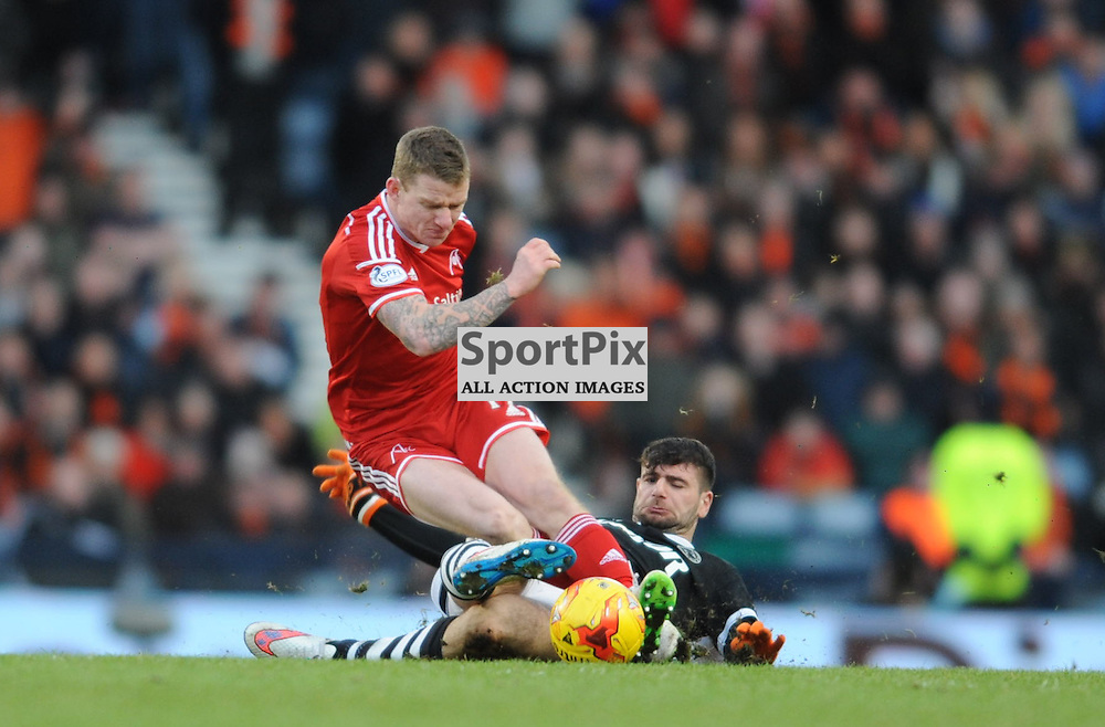 Nadir Ciftci slides in and tackles Jonny Hayes<br /> .....(c) Angie Isac | SportPix.org.uk