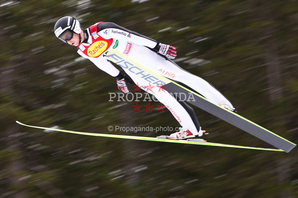 10.12.2011, Ramsau am Dachstein, AUT, FIS Nordische Kombination, Ski Sprung, im Bild Tim Hug (SUI) // Tim Hug of Swiss during Ski jumping at FIS Nordic Combined World Cup in Ramsau, Austria on 2011/12/10. EXPA Pictures © 2011, PhotoCredit: EXPA/ Johann Groder